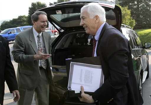 Former Penn State University assistant football coach Jerry Sandusky, right, arrives with his attorney Joe Amendola at the Centre County Courthouse in Bellefonte, Pa., today.
