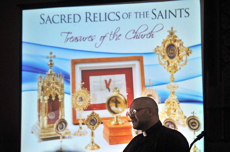 HISTORY COMES TO LIFE: The Rev. Carlos Martins brought a collection of relics to Saint Joseph's Maronite Church in Waterville on Sunday.