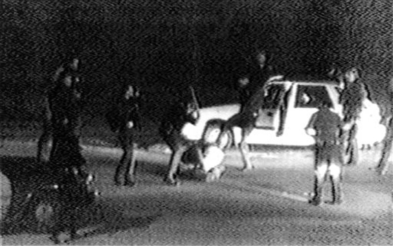 This March 31, 1991 image made from video shot by George Holliday shows police officers beating a man, later identified as Rodney King. King, the black motorist whose 1991 videotaped beating by Los Angeles police officers was the touchstone for one of the most destructive race riots in the nation's history, has died, his publicist said Sunday, June 17, 2012. He was 47. (AP Photo/Courtesy of KTLA Los Angeles, George Holliday)