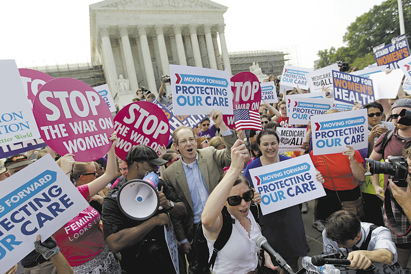 Supporters of President Barack Obama's health care law celebrate Thursday outside the Supreme Court in Washington after the court's ruling.
