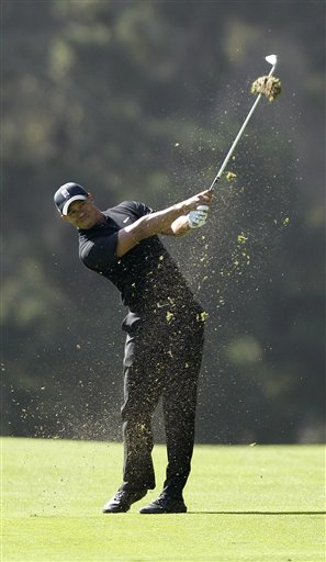 Tiger Woods hits a shot on the 14th hole during the second round of the U.S. Open Championship golf tournament Friday, June 15, 2012, at The Olympic Club in San Francisco. (AP Photo/Ben Margot)