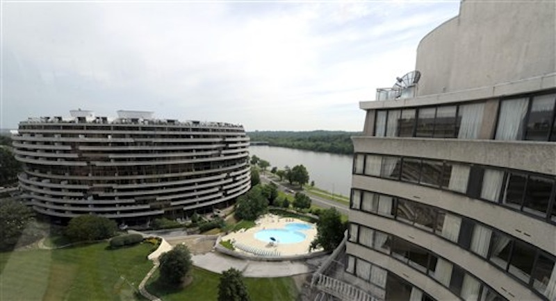This photo taken May 30, 2012 shows a view of the Watergate complex from the top floor of the Watergate Office Building in Washington Forty years ago police in Washington arrested five men breaking in to the Democratic National Committee offices in Washington. The name of the complex they were breaking into became infamous: the Watergate. These days, though, unless you know where to look, thereís little marking the location of the 1972 crime that ultimately led to the resignation of President Richard Nixon. The office building that was the site of the break in is still in use, though the tenants have changed. The adjacent hotel where the burglars stayed is currently closed. And another hotel across the street where a lookout waited with a walkie-talkie, monitoring the burglars' progress, has been turned into a college dorm. (AP Photo/Susan Walsh)
