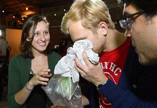 Konstantin Bakhurin smells a shirt as Martina Desalvo, left, and Neelroop Parikfhak look on during a pheromone party recently in Los Angeles.