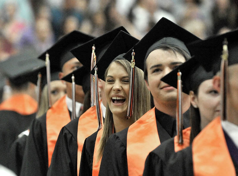 Regan Beals smiles as Winslow High School's class of 2012 marches into Wadsworth Gymnasium at Colby College in Waterville on Wednesday.