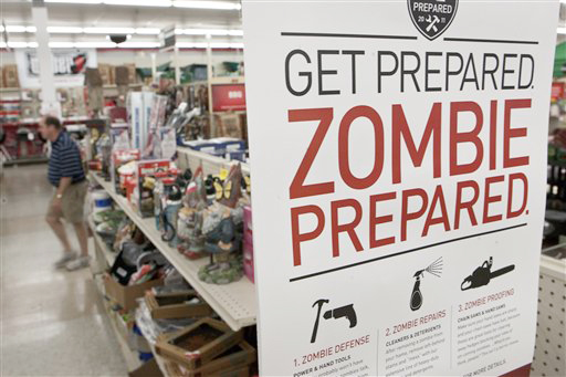 A sign promoting zombie preparedness is displayed in a hardware store in Omaha, Neb. After several gory incidents that have been reported around the country recently, online zombie talk has grown.