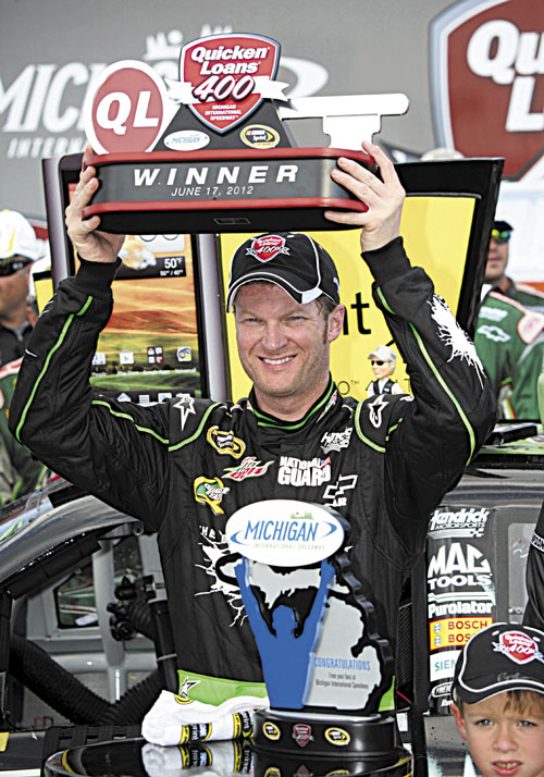 FINALLY: Dale Earnhardt Jr. lifts the trophy after winning the NASCAR Sprint Cup Series Quicken Loans 400 at Michigan International Speedway on Sunday in Brooklyn, Mich. It was Earnhardt's first win in four years.