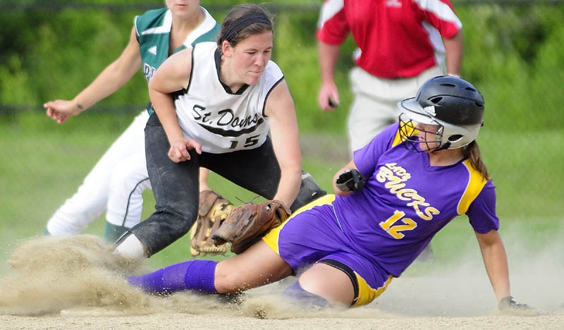 OUT: St. Dom's second baseman Mary Caron tags out Buckfield's Mindy Pye at third during the Senior High School All-Star Class C/D game Thursday evening at Cony Family Field in Augusta.