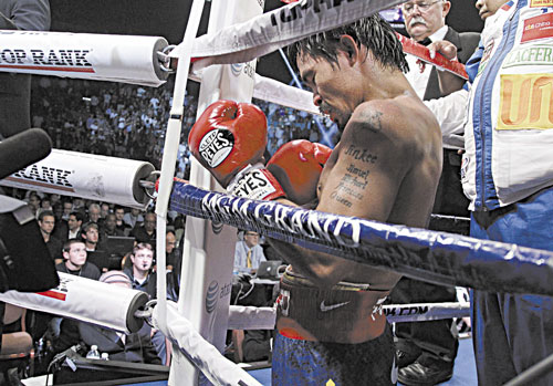 TOUGH LOSS: Manny Pacquiao kneels in his corner following his split decision loss to Timothy Bradley in their WBO world welterweight title fight Saturday in Las Vegas.