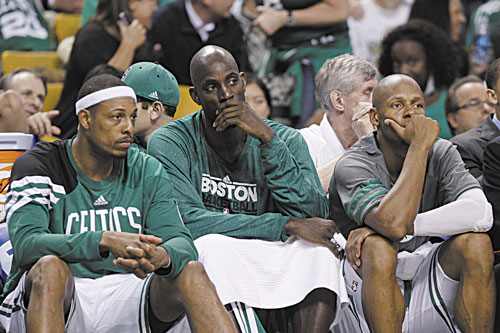 COMING BACK? Boston's Paul Pierce, left, Kevin Garnett, center, and Ray Allen, right, sit on the bench near the end of the fourth quarter of Game 6 against the Miami Heat in their Eastern Conference finals playoff series Thursday in Boston. Pierce will be back next season but Garnett and Allen are eligible for free agency.