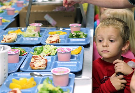 In this Tuesday, Nov. 1, 2011 file photo pre-K student Titus Bailey waitd in line for his lunch tray at West Hamlin Elementary School in West Hamlin, W. V. The nation�s school districts are turning up their noses at �pink slime,� the beef product that caused a public uproar earlier this year. The U.S. Department of Agriculture says the vast majority of states participating in its National School Lunch Program have opted to order ground beef that doesn�t contain the product known as lean finely textured beef. (AP Photo/The Herald-Dispatch, Lori Wolfe)
