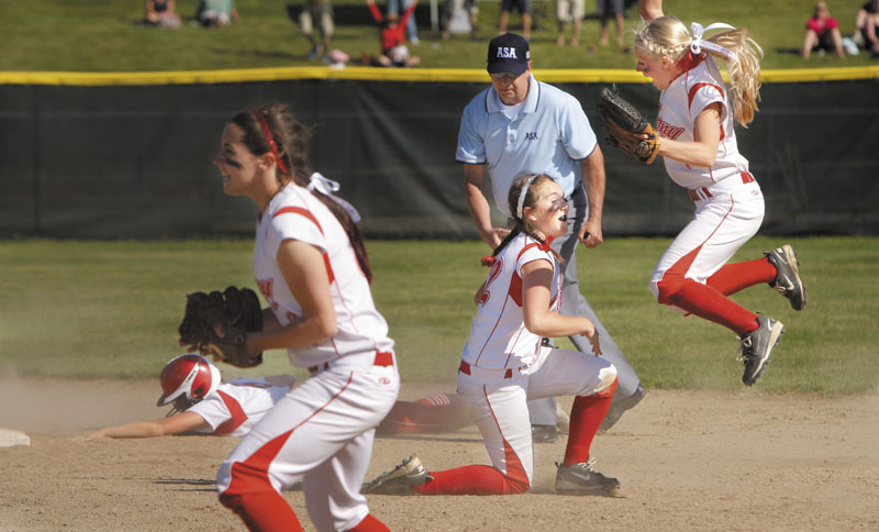 YES: Cony's Alyssa Brochu, right, jumps into the air in after Alyssah Dennett, center, tagged Danica Gleason of South Portland out at second base for the last out in the Class A softball state championship game Saturday at St. Joseph's College in Standish. Cony finished its perfect season with a 2-0 win over South Portland.