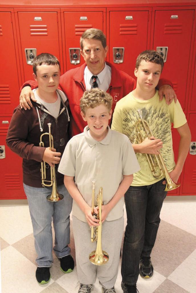 MUSIC MAN: Cony band director Dwight Tibbetts is retiring after 32 years. His band, which includes Patrick Greene, left, Aaron Gray, front, and Noah Guerrette, right, will perform its spring concert — Tibbetts last — Monday night in the William and Elsie Viles Auditorium.