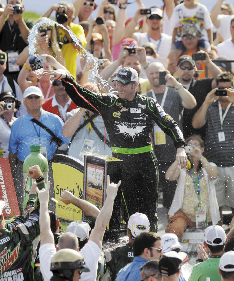 FINALLY: Dale Earnhardt Jr. celebrates in victory lane after winning the NASCAR Sprint Cup Series Quicken Loans 400 on Sunday at Michigan International Speedway.