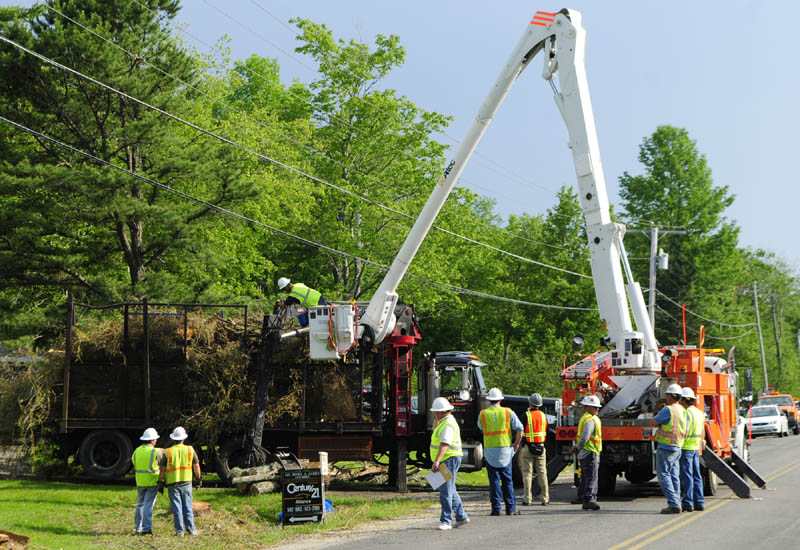 Investigators take measurements of the logging truck where a man was electrocuted on Spears Corner Road in West Gardiner on Friday afternoon. Ronald M. Hickey, 53, was working as an independent contractor for Central Maine Power to clear utility lines when the deadly incident occurred, according to Deputy Aaron Moody of the Kennebec County Sheriff's Office.