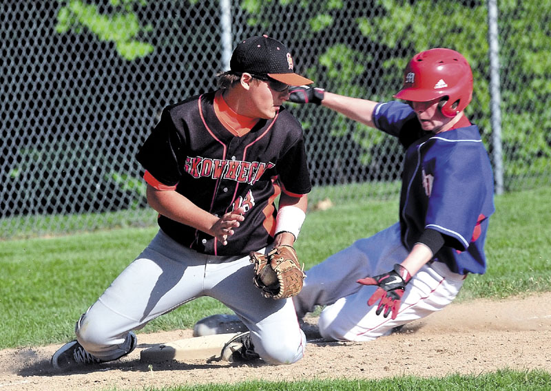 Staff photo by David Leaming Skowhegan's Kam Nelson gets Messalonskee's Trevor Gettig out at third base during game in Skowhegan on Monday.
