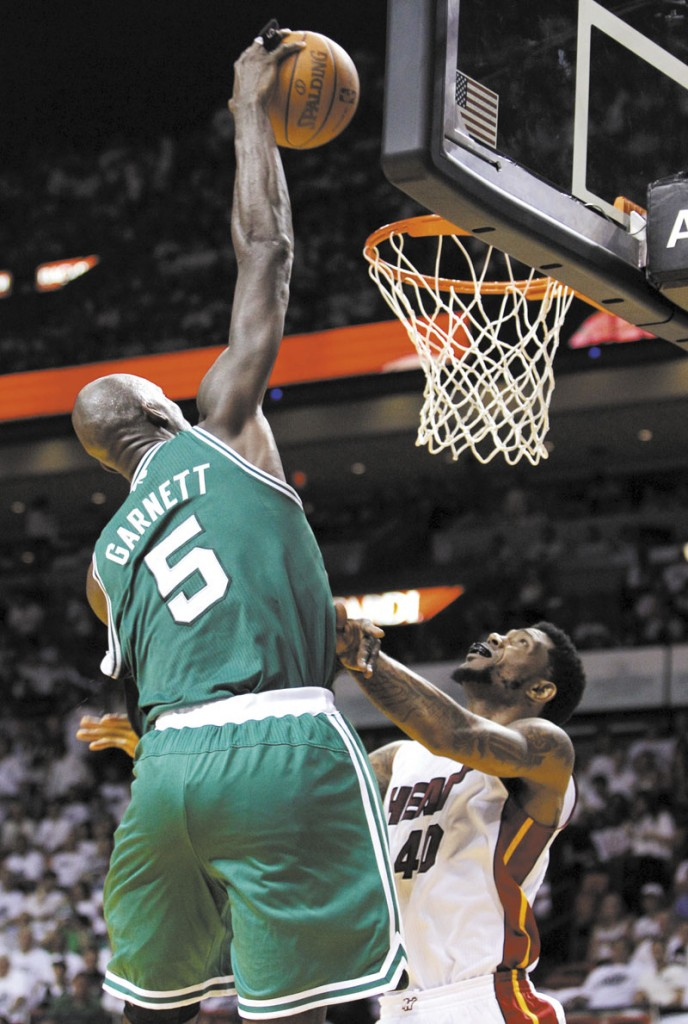 THAT'S THE TICKET: Boston Celtics' center Kevin Garnett (5) dunks over Miami Heat's Udonis Haslem (40) during the second half of the Celtics 94-90 win in Game 5 of the Eastern Conference finals Tuesday in Miami.