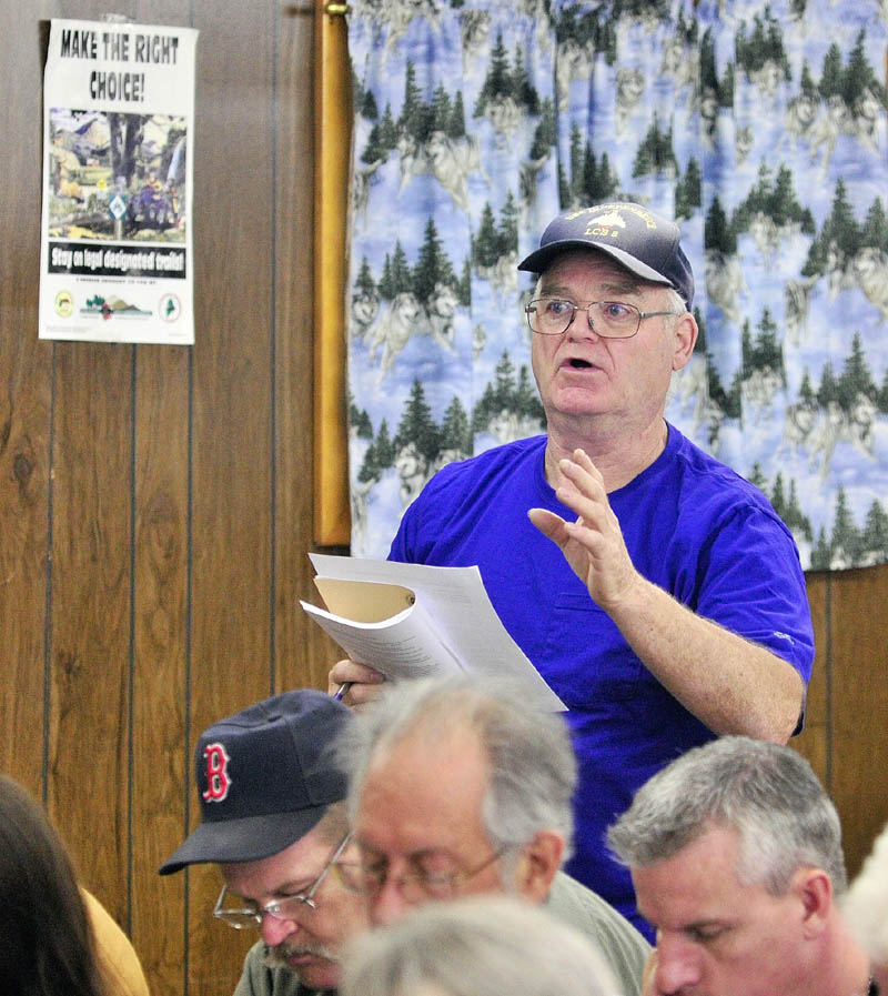 Howard Campbell joins in the debate of an ordinance banning fireworks during Litchfield's town meeting on Saturday afternoon.