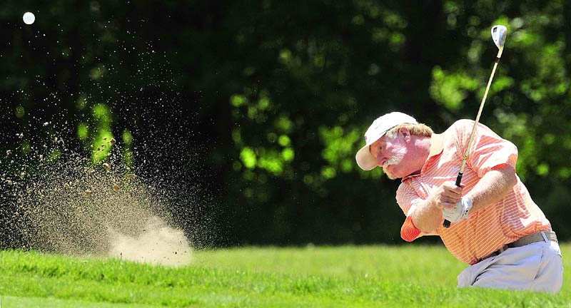 Staff photo by Joe Phelan Mark Plummer hits out of a bunker on second hole on the first day of the Charlie's Maine Open Championship on Tuesday at the Augusta Country Club in Augusta.