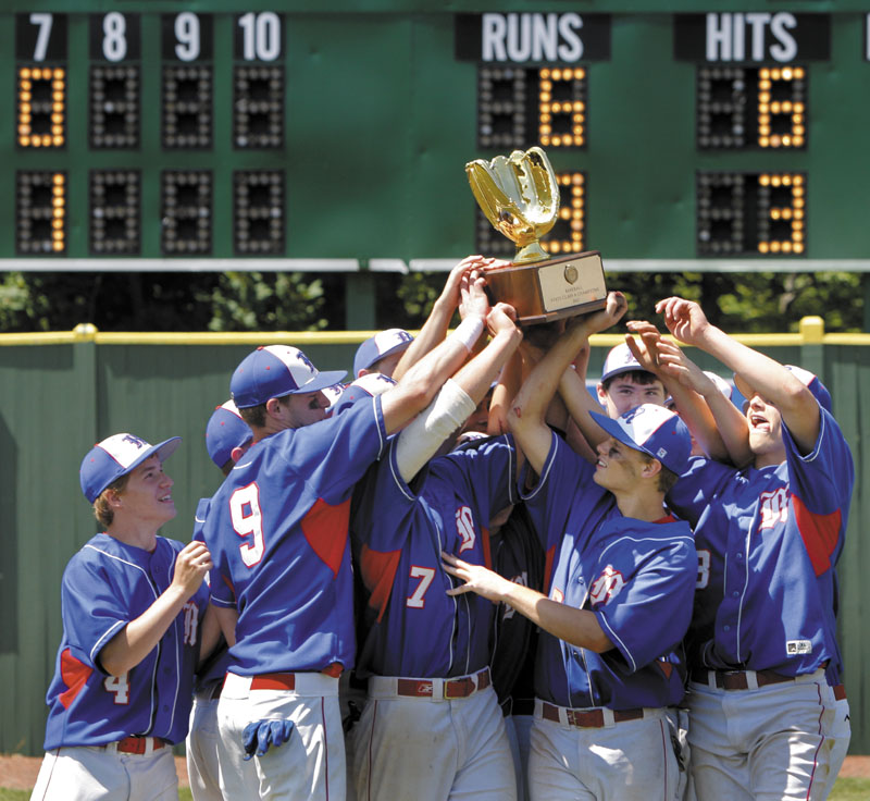 Gregory Rec/Staff Photographer: Messalonskee players hoist the championship trophy after defeating Scarborough 6-3 in the Class A state final baseball championship at St. Joseph's College in Standish on Saturday, June 16, 2012.