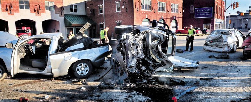 CRASH: Police look over the scene of a six-car accident on College Avenue in Waterville on March 18. The driver charged with causing the accident is in jail after she was indicted by a grand jury.