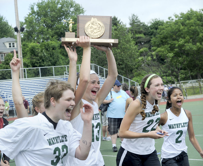 Left to right, Katherine Torrey, Sadie Cole, Jo Moore and Hannah Thompson-Greaves celebrate Saturday after Waynflete's victory in the Class B girls' lacrosse final.