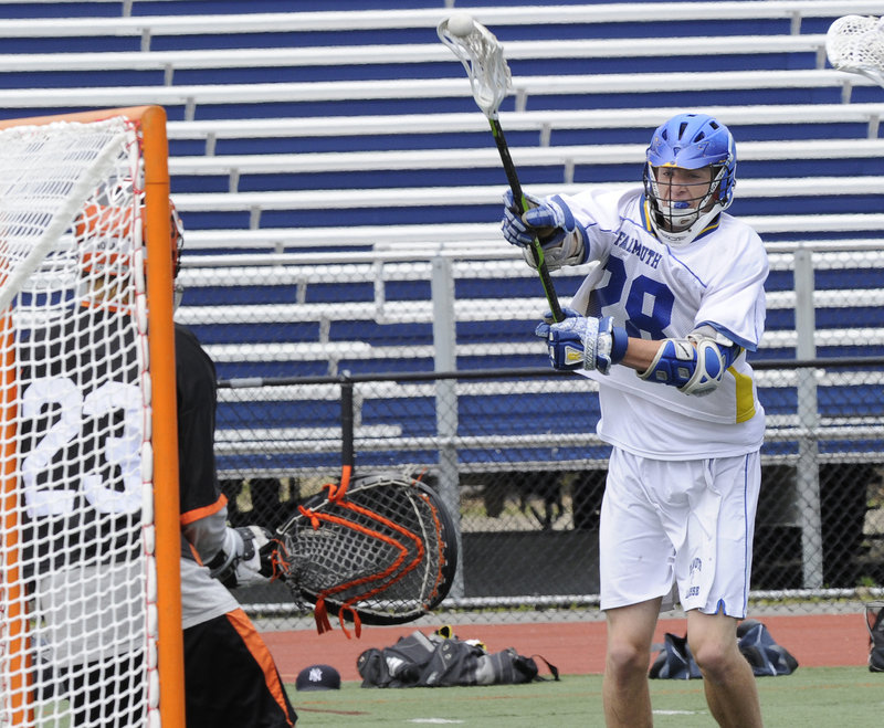 Charlie Fay, who scored three goals for Falmouth, whips a shot against North Yarmouth Academy goalie Weston Nolan during the Class B boys' lacrosse state final Saturday at Fitzpatrick Stadium. Falmouth won, 7-4.