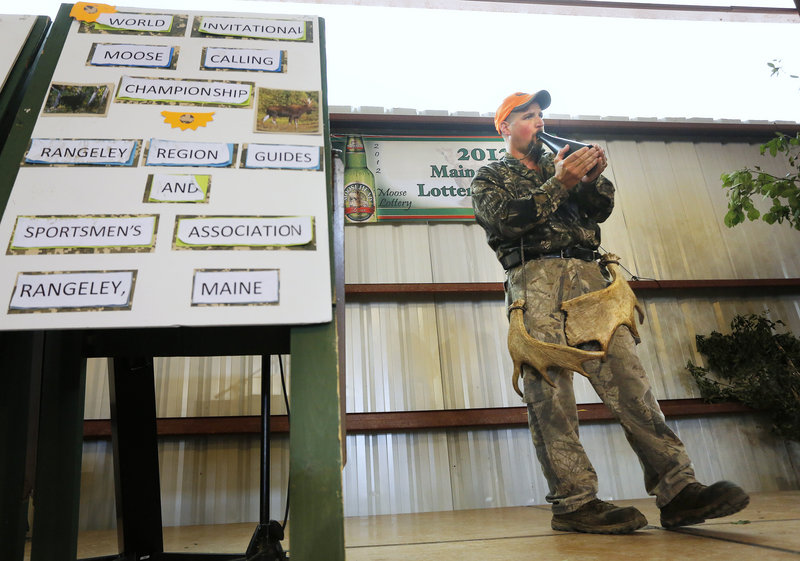Moose Calling World Championships and Moose Lottery in Oquossoc. Kevin Deschaine of Madawaska, the 2012 moose calling champion, demonstrates a call during the competition. Photographed on Saturday, June 23, 2012.