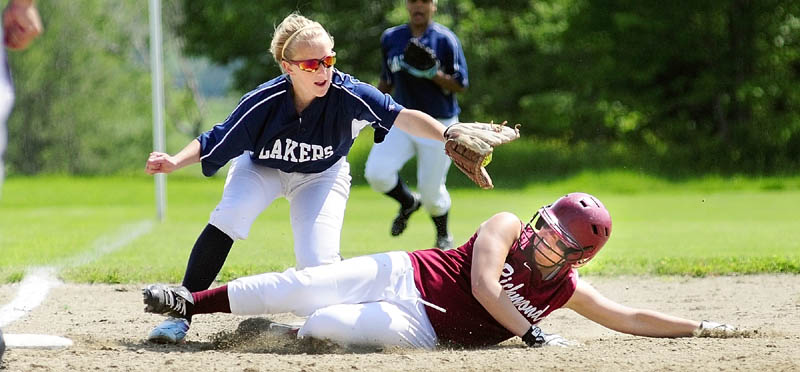 GET DOWN: Richmond baserunner Payton Johnson avoids a tag at third base by Greenville shortstop Miranda Drinkwater during the Bobcats' 7-1 win in a Western Maine Class D semifinals Friday in Richmond.