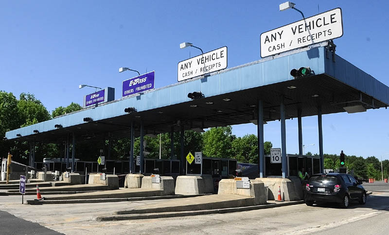Vehicles go through the Mile 101 toll plaza on the Maine Turnpike on Friday in West Gardiner.