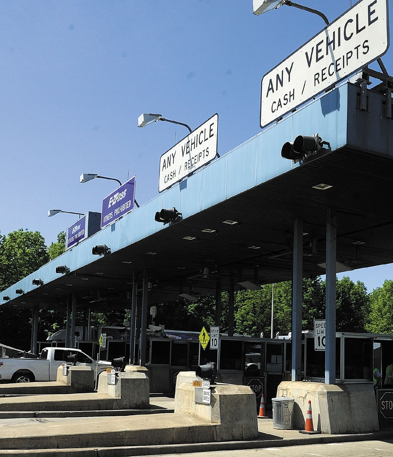 Vehicles go through the Mile 101 toll plaza on the Maine Turnpike (Interstate 95) in West Gardiner. The Turnpike Authority has proposed another toll increase, the third in less than a decade.