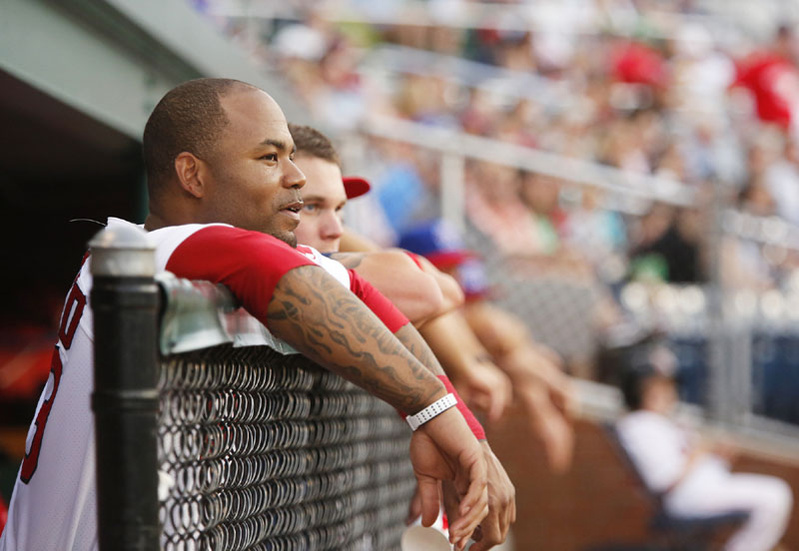Red Sox outfielder Carl Crawford watches the action from the dugout at a Portland Sea Dogs game on July 3.