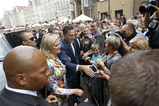 Republican presidential candidate and former Massachusetts Gov. Mitt Romney and wife Ann wave to the crowd at The Gdansk Old Town Hall, in Gdansk, Poland, Monday, July 30, 2012. (AP Photo/Charles Dharapak)