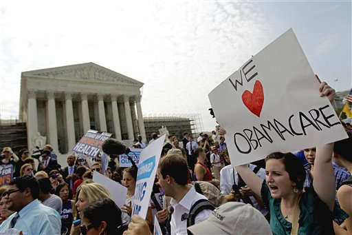FILE - In this June 28, 2012 file photo, supporters of President Barack Obama's health care law celebrate outside the Supreme Court in Washington. It looks like a tax, smells like a tax, and the Supreme Court says it must be a tax. But politicians in both parties are squirming over how to define the Thing in President Barack Obama's health care law that requires people to pay up if they don't get health insurance. The problem for Obama is that, if the Thing is indeed a tax, he is by definition a raiser of taxes on the middle class, which he promised not to be. If that sounds like an opportunity for Republican presidential rival Mitt Romney, well, it's not that simple. (AP Photo/David Goldman, File)