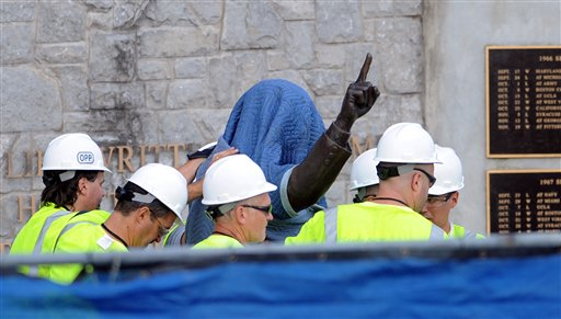 Workers from the Penn State Office of Physical Plant cover the statue of former football coach Joe Paterno near Beaver Stadium in State College, Pa., on Sunday prior to the statue's removal.