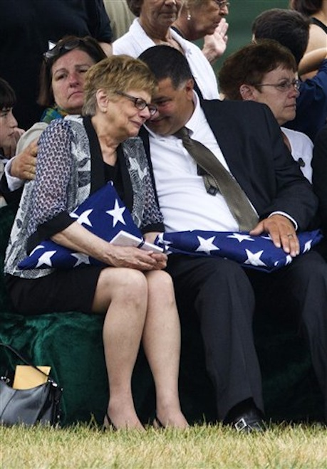 "Barbara Annechino is comforted by her brother Jeffrey Christiano during the burial service for their father Air Force Col. Joseph Christiano, and Col. Derrell B. Jeffords, Lt. Col. Dennis L. Eilers, Chieft Master Sgt. William K. Colwell, Chief Master Sgt. Arden K. Hassenger and Chief Master Sgt. Larry C. Thornton, Monday, July 9, 2012, at Arlington National Cemetery Arlington, Va. It was Christmas Eve 1965 when the Air Force plane nicknamed ""Spooky"" took off from Vietnam for a combat mission. The crew sent out a ""mayday"" signal while flying over Laos, and after that, all contact was lost. Two days of searches turned up nothing. (AP Photo/Haraz N. Ghanbari)"