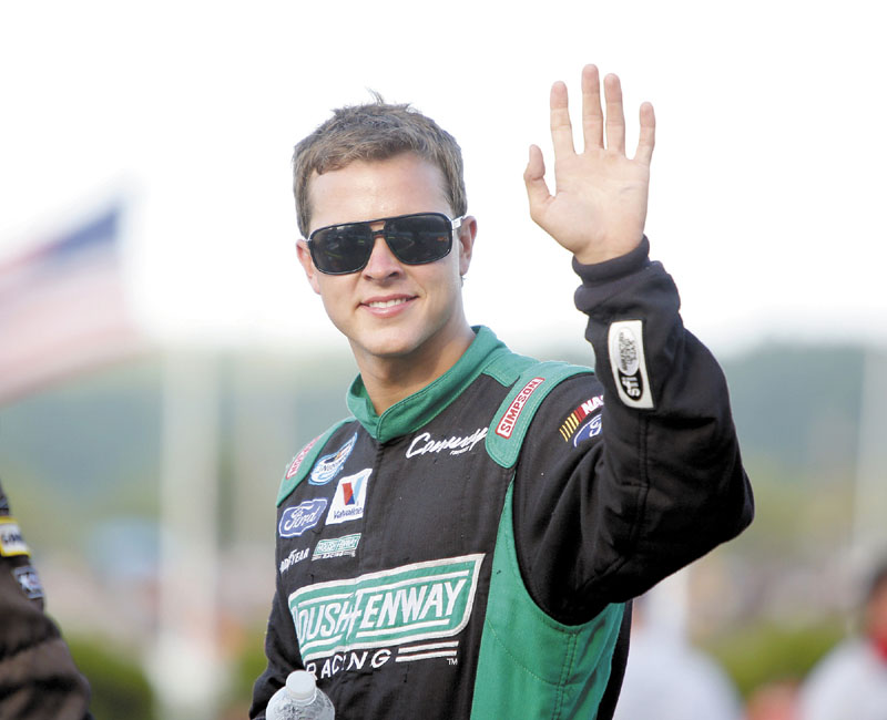 NASCAR driver Trevor Bayne waves to the crowd during driver introduction before the start of the TD Bank 250 on Sunday at Oxford Plains Speedway in Oxford.
