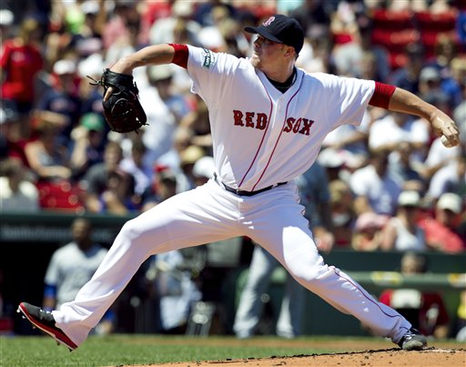 Boston Red Sox's Jon Lester delivers a pitch against the Toronto Blue Jays in the first inning of a baseball game at Fenway Park in Boston, Sunday, July 22, 2012. The Blue Jays won 15-7. (AP Photo/Steven Senne)