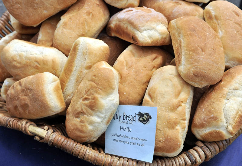 Fresh loaves from Daily Bread sit on display at the Daily Bread tent at the Artisan Bread Fair at the Skowhegan State Fairgrounds on Saturday.
