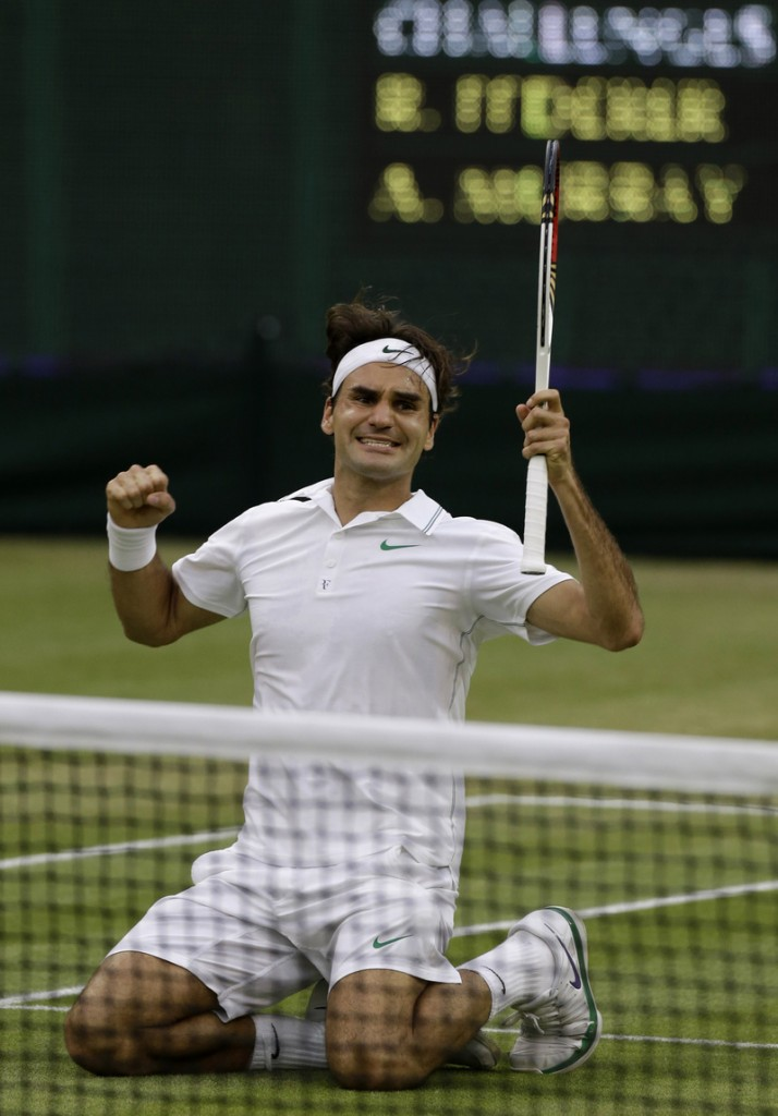 Roger Federer of Switzerland celebrates winning the men's singles final against Andy Murray of Britain at the All England Lawn Tennis Championships at Wimbledon, England, Sunday.
