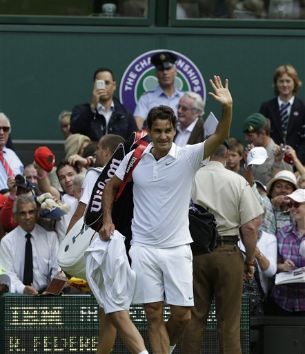 Roger Federer of Switzerland during a quarterfinals match against Mikhail Youzhny of Russia at the All England Lawn Tennis Championships at Wimbledon, England, Wednesday July 4, 2012. (AP Photo/Anja Niedringhaus)