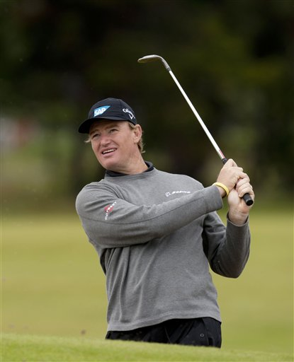 South Africa's Ernie Els hits a shot out of a bunker during a practice round at the Royal Lytham & St Annes golf club before the forthcoming British Open Golf tournament, Lytham St Annes, England, Monday, July 16, 2012. (AP Photo/Jon Super)