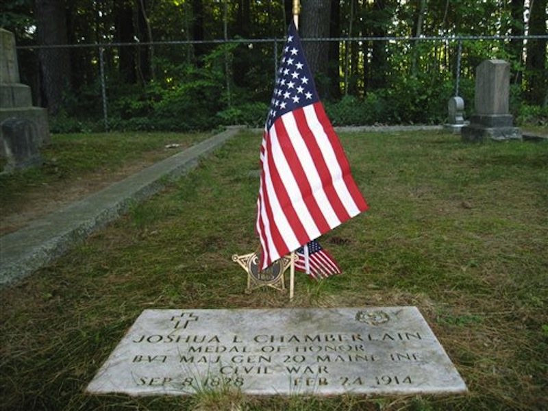This July 12, 2012 photo shows the plaque at the gravesite in Pine Grove Cemetery in Brunswick, Maine, where Joshua Chamberlain is buried. During the Civil War, Chamberlain led Union forces during the Little Round Top victory at the Battle of Gettysburg and later accepted the Confederacy surrender at Appomattox in Virginia. (AP Photo/Beth Harpaz)