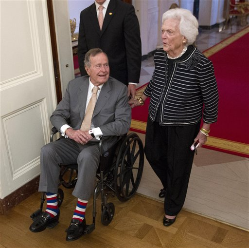 Former President George H.W. Bush and former first lady Barbara Bush arrive in the East Room of the White House in Washington on May 31 for a ceremony to unveil the official portrait of their son former President George W. Bush. Bush and his wife Barbara won't be attending the Republican National Convention next month in Tampa because of health reasons. (AP Photo/Pablo Martinez Monsivais)