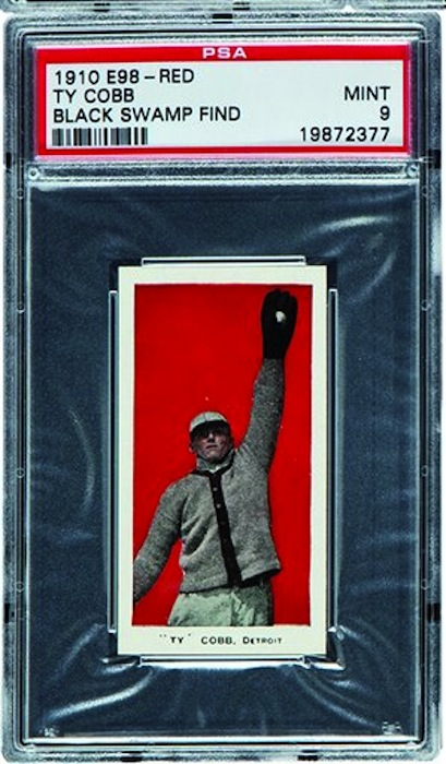 This undated photo provided by Heritage Auctions of Dallas, shows a 1910 E98 Ty Cobb baseball card found in the attic of a house in Defiance, Ohio with about 700 others. The best of the bunch – 37 cards – are expected to bring a total of $500,000 when they are sold at auction in August during the National Sports Collectors Convention in Baltimore. (AP Photo/ Heritage Auctions)