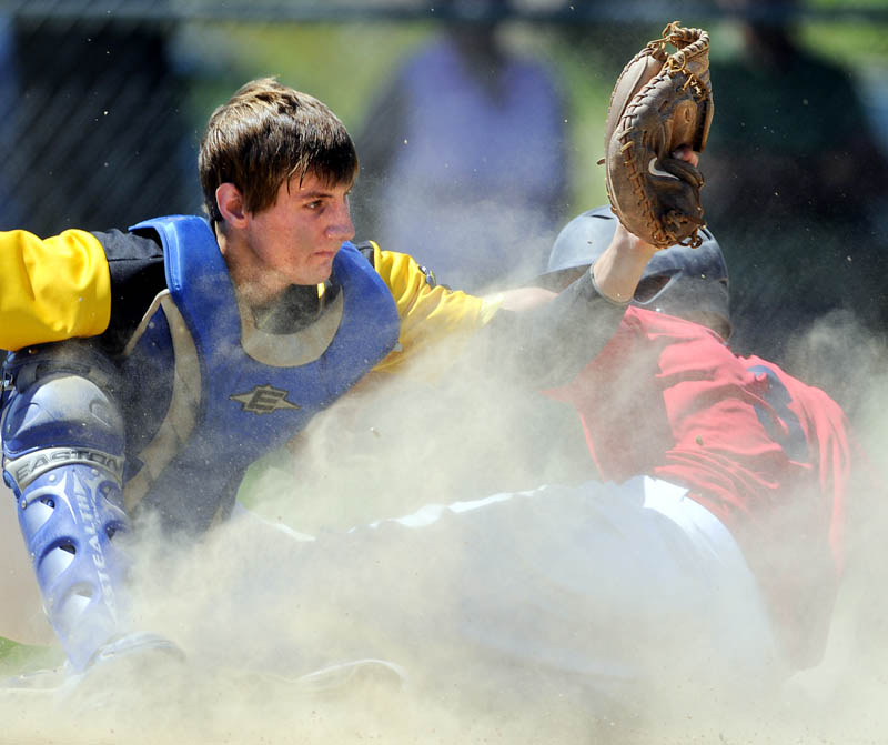 CLOSE PLAY: South China Subway catcher Keith Cloutier tags out Post 51's Josh Doolan at the plate Sunday during Post 51's 11-10 win in the Zone 2 American Legion tournament in Augusta.