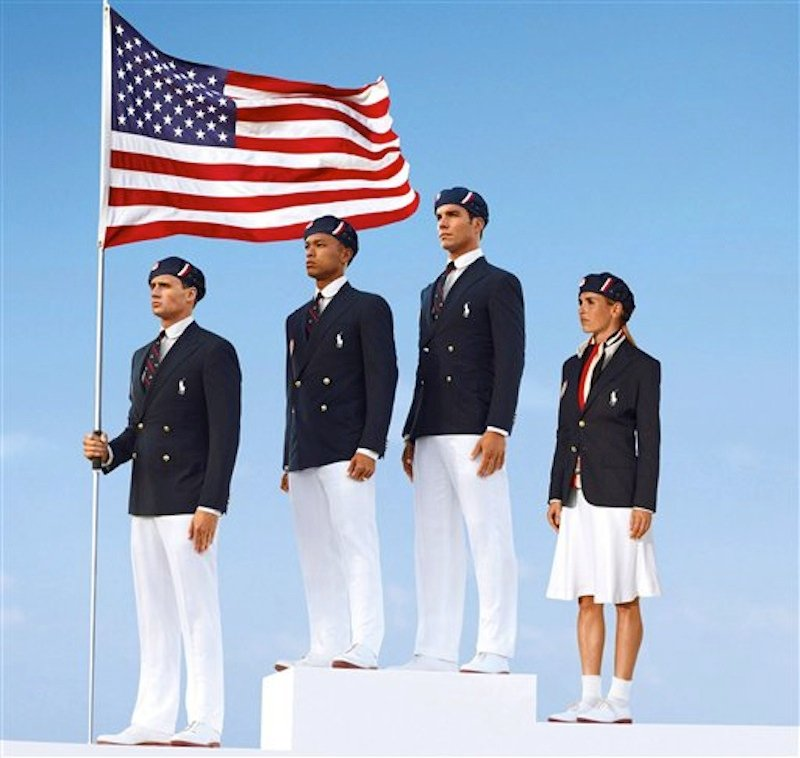 This product image released by Ralph Lauren shows U.S. Olympic athletes, from left, swimmer Ryan Lochte, decathlete Bryan Clay, rower Giuseppe Lanzone and soccer player Heather Mitts modeling the the official Team USA Opening Ceremony Parade Uniform. Republicans and Democrats railed Thursday, July 12, 2012 about the U.S. Olympic Committee's decision to dress the U.S. team in Chinese manufactured berets, blazers and pants while the American textile industry struggles economically with many U.S. workers desperate for jobs. (AP Photo/Ralph Lauren, File)