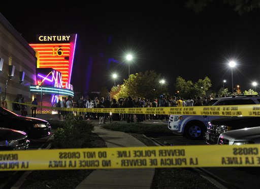 People gather outside the Century 16 movie theater in Aurora, Colo., at the scene of a mass shooting early this morning. Police say 12 people are dead following the shooting at the suburban Denver theater.