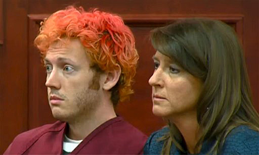 James Holmes, left, the suspected gunman in the Colorado theater massacre during his first appearance in court with his attorney Tamara Brady in Centennial, Colo. last Monday.