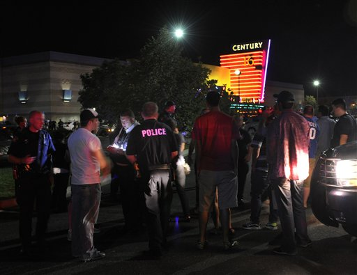 Police take witness statements outside the Century 16 movie theater in Aurora, Colo., following an early morning mass shooting.