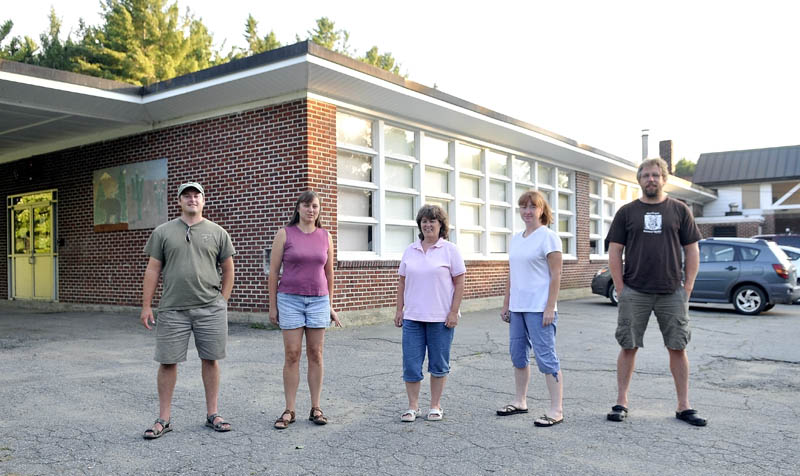 """Cornville Regional Charter School organizers from left to right, executive director, Justin Belanger, and board members Sandra Belanger, Jean Walker, Jessica """"Jake"""" Daigneault, and Jason Cooke outside the Cornville Elementary School on Wednesday."""